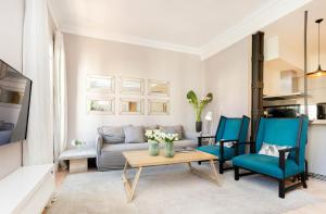 Ein Sitzbereich in der Unterkunft Apartamento premium de 3 habitaciones junto al Retiro