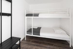 Un ou plusieurs lits superposés dans un hébergement de l'établissement City Stays Cais do Sodre Apartments