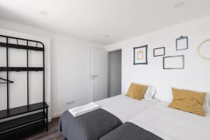 Un ou plusieurs lits dans un hébergement de l'établissement City Stays Cais do Sodre Apartments