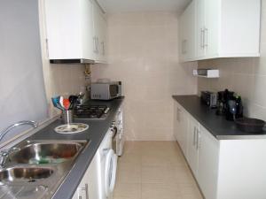 A kitchen or kitchenette at Marsol Flat