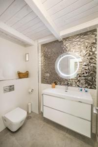 Un baño de Palacio del Agua Apartamentos