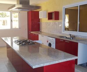 A kitchen or kitchenette at Village du golf Midoun
