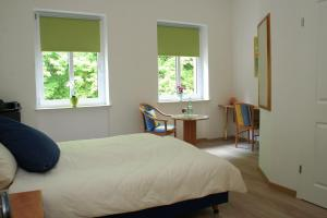 A bed or beds in a room at Wald Villa Üssbach