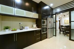A kitchen or kitchenette at Spice Arena House