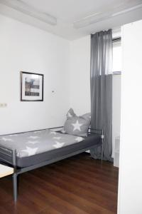 A bed or beds in a room at IVFI Immobilien