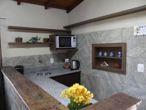 A kitchen or kitchenette at Recanto 438