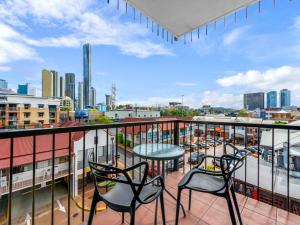 A balcony or terrace at Central Brunswick Apartment Hotel
