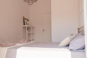 A bed or beds in a room at Ayerina semi-detached Villas