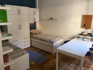 A bed or beds in a room at Temporary Family House