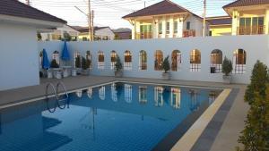 สระว่ายน้ำที่อยู่ใกล้ ๆ หรือใน Cozy House in Hua Hin, Thailand