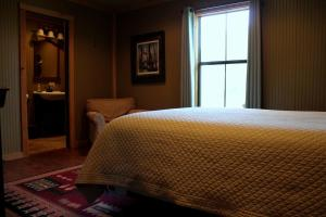 A bed or beds in a room at Eagle Lodge at Crying Eagle Lodging Company
