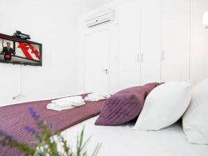A bed or beds in a room at Apartment PRCORA308