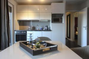 A kitchen or kitchenette at Parkhotel Heidehof Long Stay
