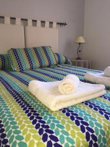 Una cama o camas en una habitación de Los Cerros 2