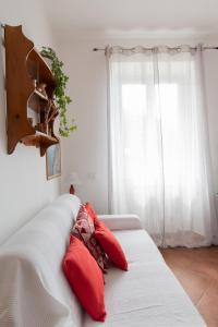 A bed or beds in a room at Appartamento Giovanna