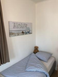 Een bed of bedden in een kamer bij Knokke Boudewijnlaan