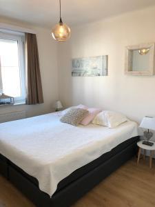Un ou plusieurs lits dans un hébergement de l'établissement Knokke Boudewijnlaan