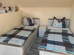 Ein Bett oder Betten in einem Zimmer der Unterkunft FeWo Familie Groß