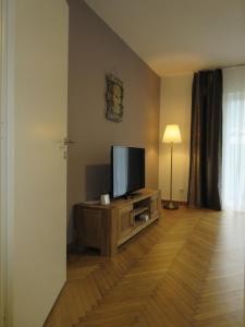 TV/Unterhaltungsangebot in der Unterkunft Home Apartments