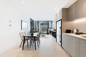 A kitchen or kitchenette at Brand New Ultra Modern CBD View