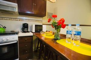 A kitchen or kitchenette at La Villa Di Ana