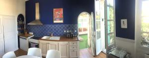 A kitchen or kitchenette at Maison de Fogasses : Luxury Apartments