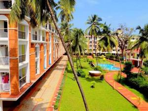 A view of the pool at Monarch Palms Candolim or nearby