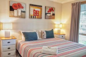 A bed or beds in a room at Roviana