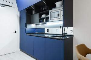 A kitchen or kitchenette at Gran Via Centric