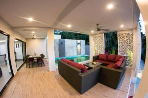 A seating area at The Elegance Pool Villas