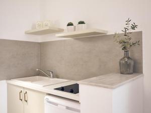 A kitchen or kitchenette at Villaggio Studios & Apartments