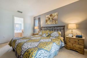 A bed or beds in a room at Lovely 4 bedroom home at Terra Verde