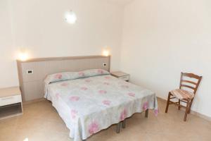 A bed or beds in a room at Bilocale Corte di Gallura
