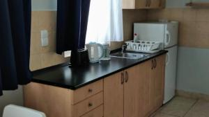 A kitchen or kitchenette at Akacfa Holiday Apartments