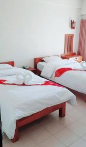 Una cama o camas en una habitación de Veerasuda Condotel