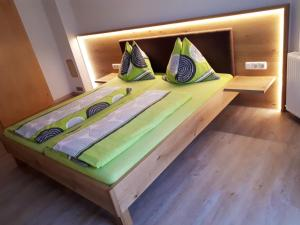 Ein Bett oder Betten in einem Zimmer der Unterkunft Ferienhaus Sporer