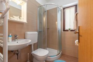 A bathroom at Apartments Prekalj