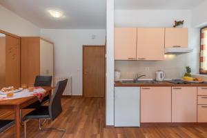 A kitchen or kitchenette at Apartments Prekalj