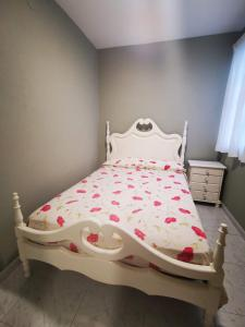 A bed or beds in a room at Apartamento Candil