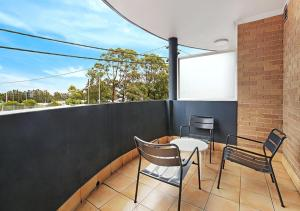 A balcony or terrace at AeA Sydney Airport Serviced Apartments