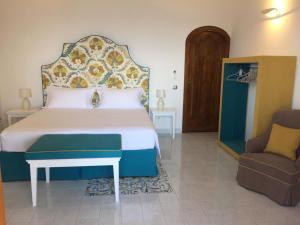 Ліжко або ліжка в номері Casa Antioco Original