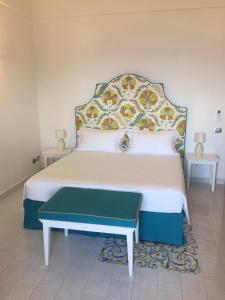Letto o letti in una camera di Casa Antioco Original