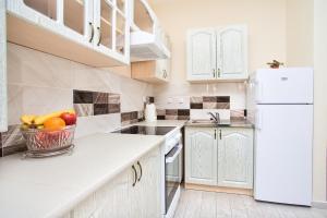 Kuchyň nebo kuchyňský kout v ubytování Sea Star Luxury Apartment
