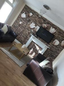 A seating area at 5 bed maisonette central Westkirby