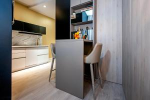 Majoituspaikan Deluxe Studio G 12 keittiö tai keittotila