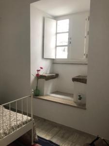 Um banheiro em Mouraria House - Casa de Charme - Centro Histórico