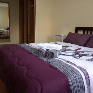 A bed or beds in a room at Arenal Suites Lugo
