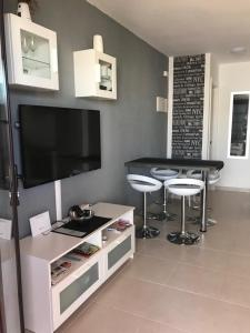 A television and/or entertainment center at Sun Beach Bungalows
