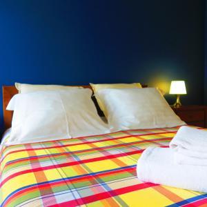 Uma cama ou camas num quarto em Dunas Apartamento