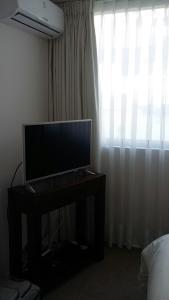 Una televisión o centro de entretenimiento en Austral Rentahome Galvarino